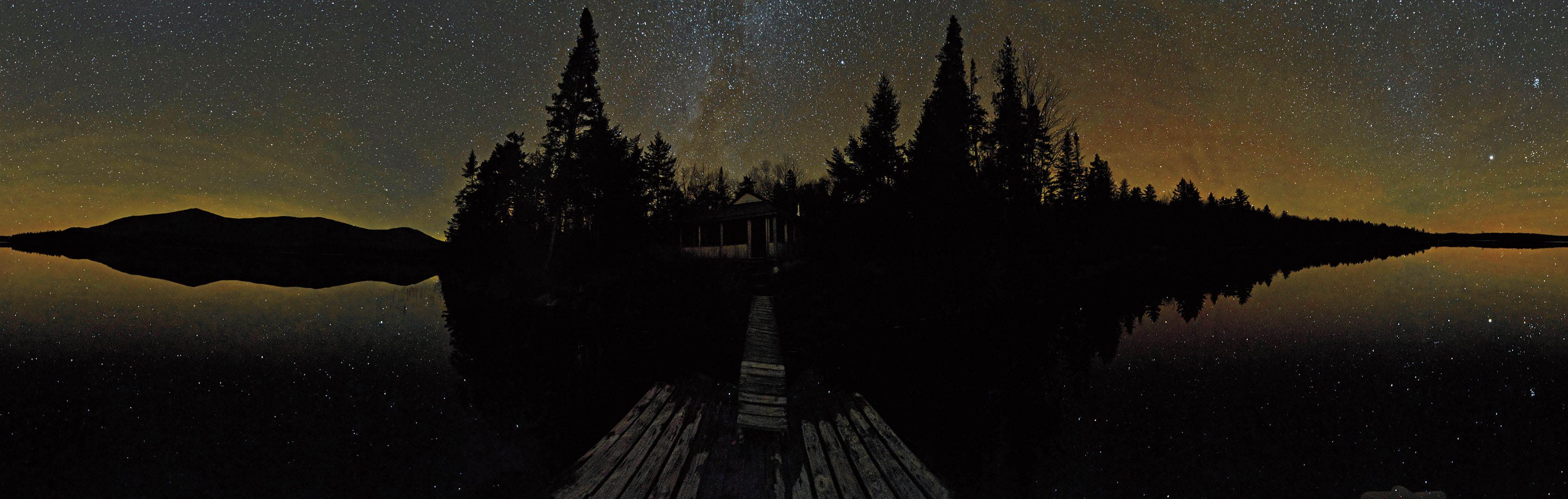 The Bates College Museum of Art exhibition Starstruck: The Fine Art of Astrophotography was a critical and popular success. Here, Will Strathmann '13 of Newtown Square, Pa., captures the Maine night sky during a Bates-sponsored photography workshop on West Branch Pond.