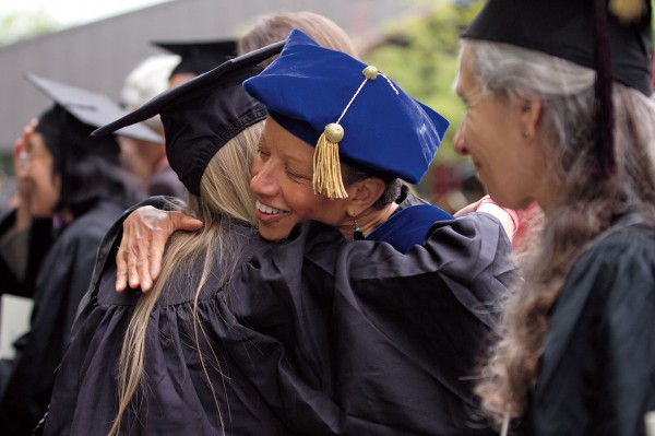 Politics professor Leslie Hill hugs a graduate after the ceremony. Photograph by Phyllis Graber Jensen