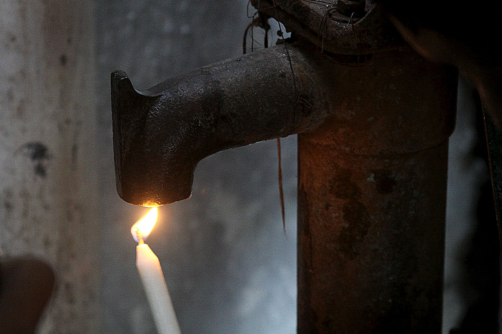 "When taking water samples, one step is ""flaming the faucet"" to kill germs clinging to the metal. Photograph by Zuhayr Reaz '16, who is doing fieldwork in Dhaka, Bangladesh, as part of his internship with WaterAid."