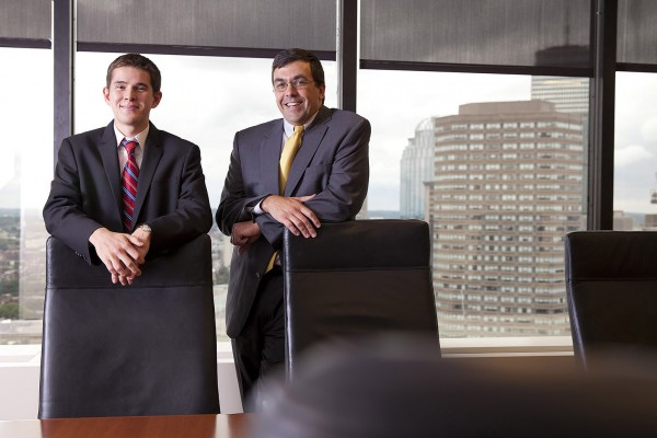 Ladd intern Zach Polich '15 and TM Capital managing director Brad Adams '92 pose at TM headquarters in Boston, located on the 25th floor of Hancock Place. (Phyllis Graber Jensen/Bates College)