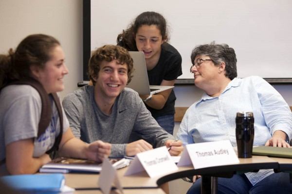 "Professor of Classical and Medieval Studies Margaret Imber consults with students during her first-year seminar ""Trials of Conscience."" (Phyllis Graber Jensen/Bates College)"