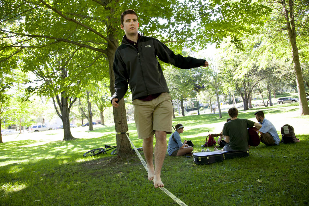 "Chris Crum '17 of Littleton, Colo., says he signed up for the Bates Slackline Club never having used a slackline. ""I tried it, and it's kind of fun,"" he said. (Marc Glass/Bates College)"