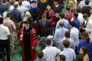 As ever, mace bearer and Professor of Sociology Sawyer Sylvester leads the Convocation procession. (Michael Bradley/Bates College)