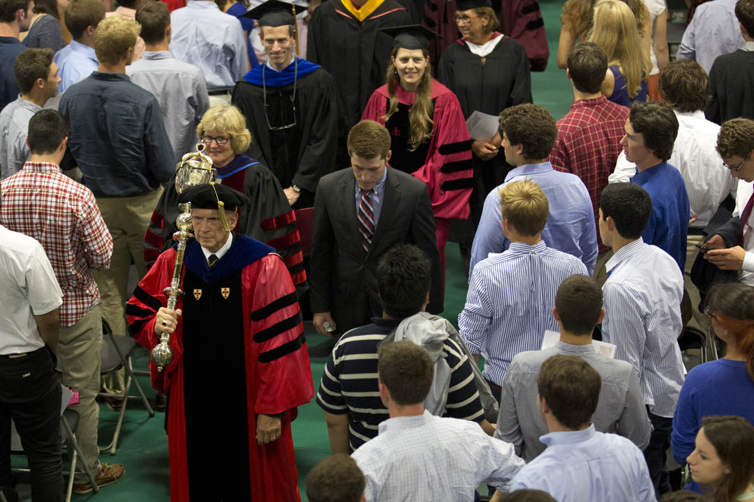Members of the faculty exit Alumni Gym at the conclusion of Convocation. (MIke Bradley/Bates College)