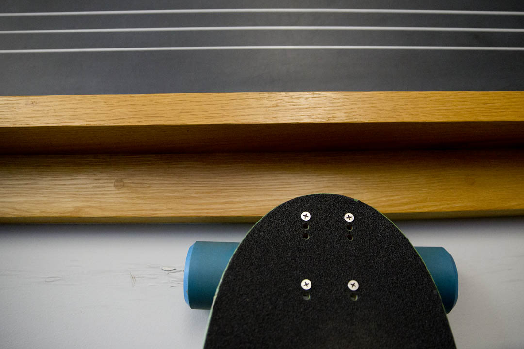 A skateboard leans against a blackboard in a music classroom in the Olin Arts Center. (Phyllis Graber Jensen/Bates College)