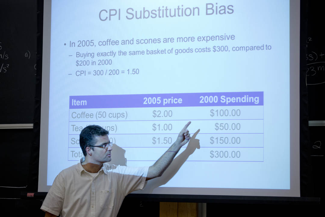 "Assistant Professor of Economics Daniel Riera-Crichton makes a point about the tendencyof consumers to purchase inexpensive substitutes for expensive items when prices change during his course, ""Principles of Macroeconomics: Income/Employmentt.""   (Phyllis Graber Jensen/Bates College)"