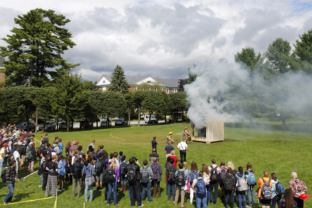 Students gather to witness a mock dorm room fire during fire safety day (Mike Bradley/Bates College)