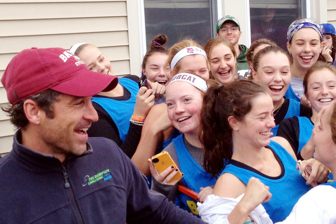 Bates participants in the CBB Challenge get close to Dempsey for a photograph. (Clayton Spencer/Bates College)
