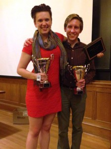 Taylor Blackburn '15 and Jac Stewart show off their first-place trophies after winning the Yale Inter-Varsity Tournament in early October. (BQDC)