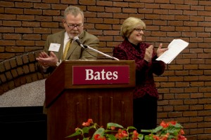 Chair of the Board of Trustees Michael Bonney '80 announces the $11.5 million Catalyst Fund gift as Bates President Clayton Spencer applauds. (Sarah Crosby/Bates College)