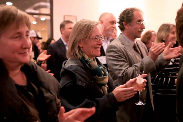 Faculty members Lillian Nayder (English), Jane Costlow (environmental studies) and Tom Wenzel (chemistry) applaud the announcement of the Catalyst Fund gift. (Phyllis Graber Jensen/Bates College)