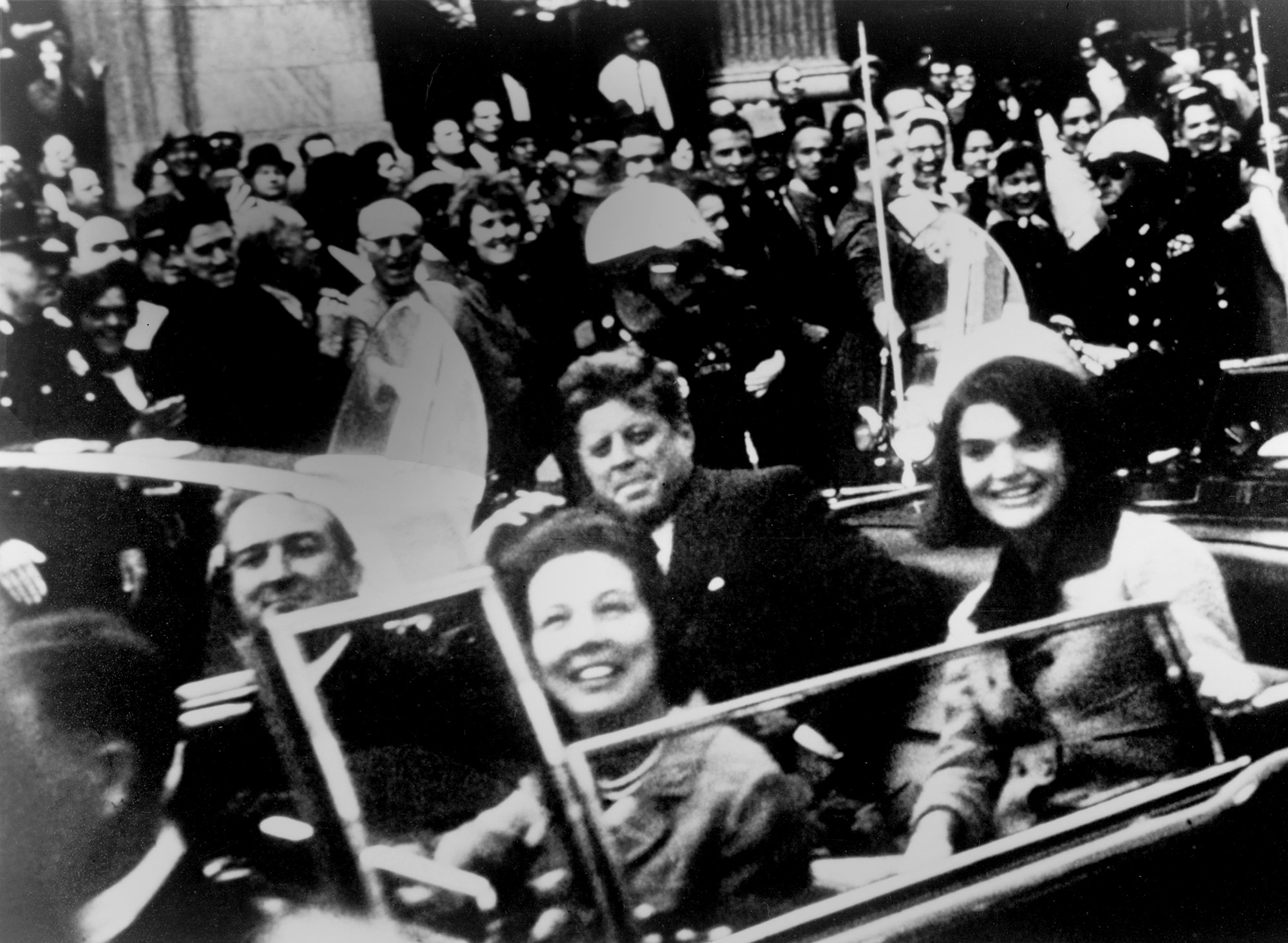 President John Kennedy and Jacqueline Kennedy ride with Texas Gov. John Connally and Nellie Connally in the presidential motorcade on Nov. 22, 1963. (Victor Hugo King / Library of Congress Prints and Photographs Division)