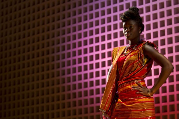 Fatima Sacko '17 of New York City models an outfit during the Inside Africa Fashion Show held Nov. 8, 2013. (Sarah Crosby/Bates College)
