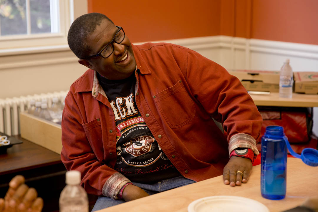 Professor of Rhetoric Charles Nero enjoys a student-faculty pizza lunch held in the department's new Pettigrew Hall lounge. (Phyllis Graber Jensen/Bates College)