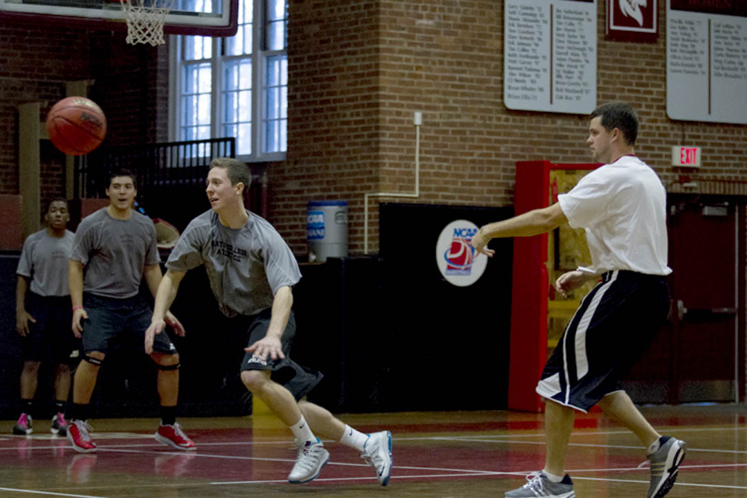 Head Coach Jon Furbush '05 (right) leads the season's first men's basketball practice at Alumni Gym on Nov. 1, 2013. (Sarah Crosby/Bates College)