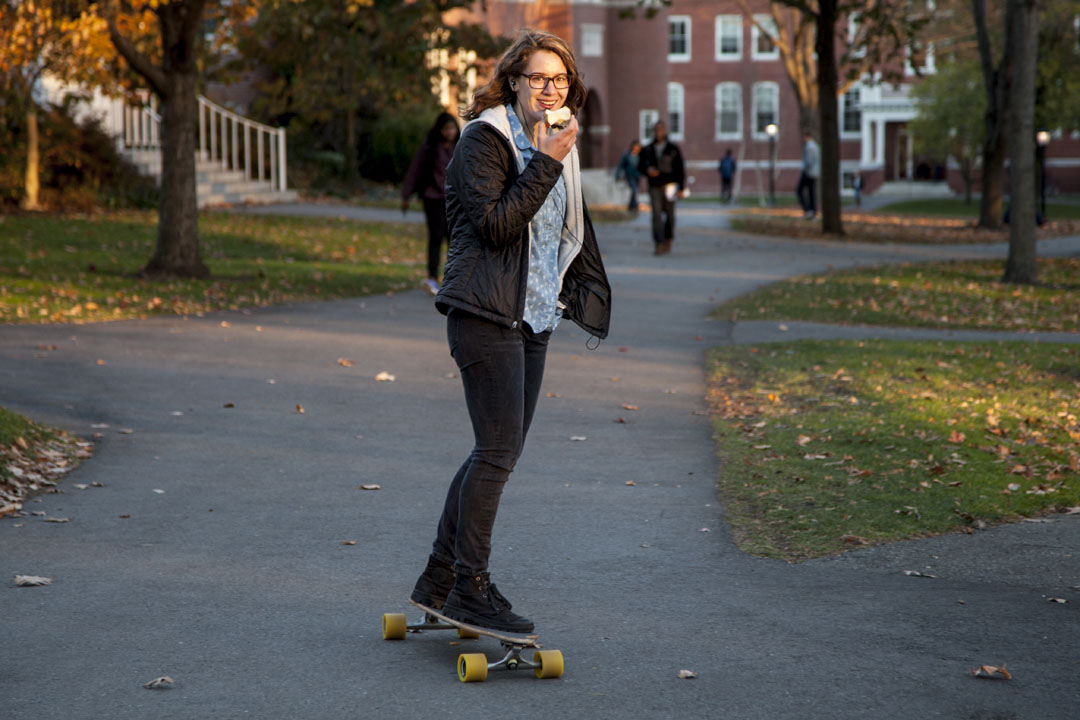 When her workload is heavy, Bates College neuroscience major Jane Mayer '14 of Bronxville, N.Y., will take as many as five laps around campus a day on her Madrid longboard. (Marc Glass '88/Bates College)