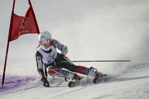 Emily Bamford '15 zooms past a gate in the giant slalom at the NCAA East Regional Meet in February 2013. (Photo: Cory Ransom)