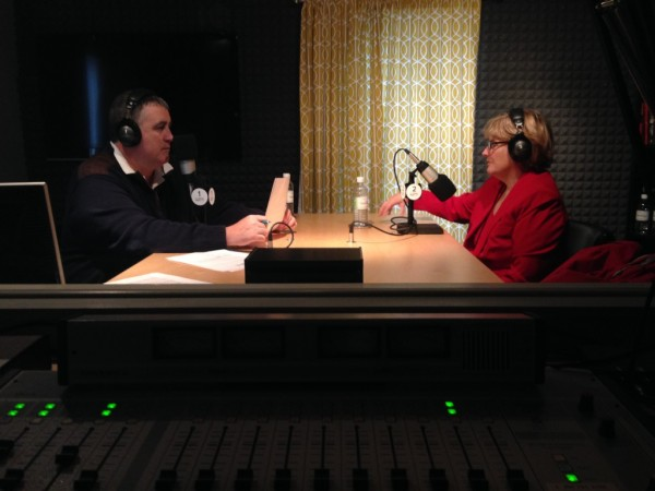 President Clayton Spencer speaks with Steve Woods of TideSmart Talk in the studio. Photo courtesy of TideSmart Radio.