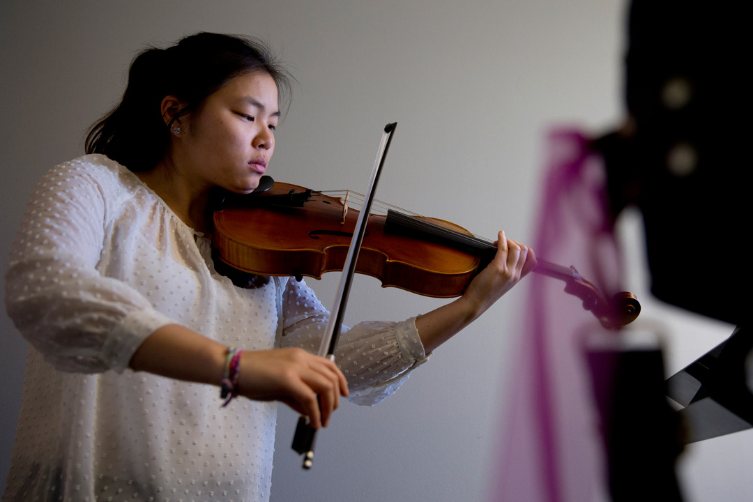"So Hee Ki '16 of Irvine, Calif., practices Richard Wagner's ""Siegfried-Idyll"" on the viola in the Olin Arts Center. (Phyllis Graber Jensen/Bates College)"