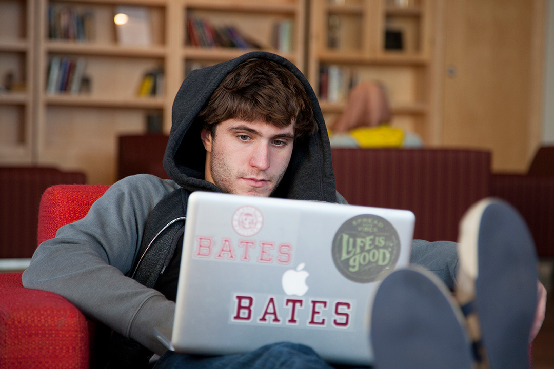 In the Fireplace Lounge of Commons, Nathan Stephansky '17 of Whitman, Mass., finds that, indeed, life is good at Bates. (Marc Glass/Bates College)