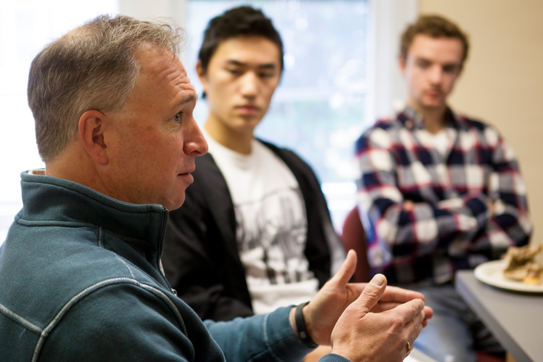 Win Brown '89, president and CEO of Heywood Healthcare, speaks with Kevin Deng '15 and Patrick Tolosky '15 about the changing culture of healthcare. (Sarah Crosby/Bates College)