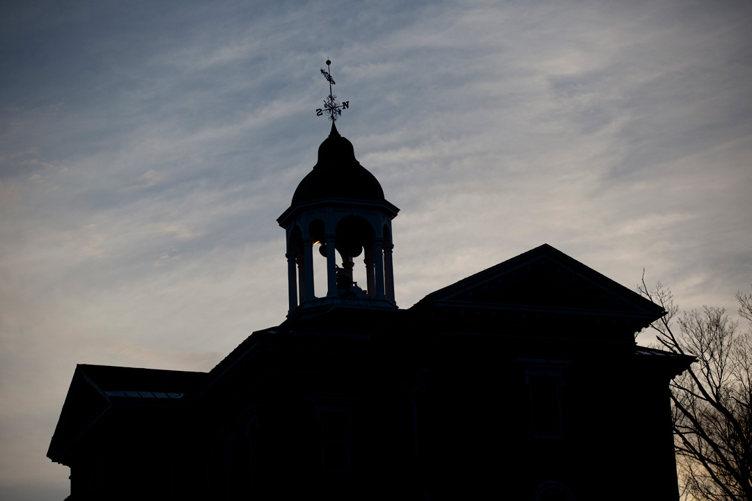 A late fall sky silhouettes historic Hathorn Hall. (Phyllis Graber Jensen/Bates College)