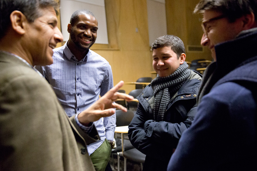 "Raj Maheshwari (left), founder and managing director of Charlestown Capital Advisors, LLC, chats with students after he and Bates Trustee Paul Marks '83 discussed ""Can a liberal arts education make you a good investor and Entrepreneur?"" at a BCDC-hosted gathering.(Phyllis Graber Jensen/Bates College)"