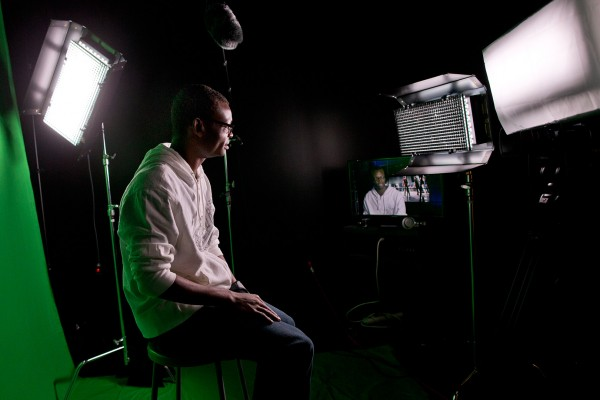 Videographer Joshua Ajamu '14 of Breinigsville, Pa., has found a second home in Pettigrew's new Digital Media Studios. (Phyllis Graber Jensne/Bates College)