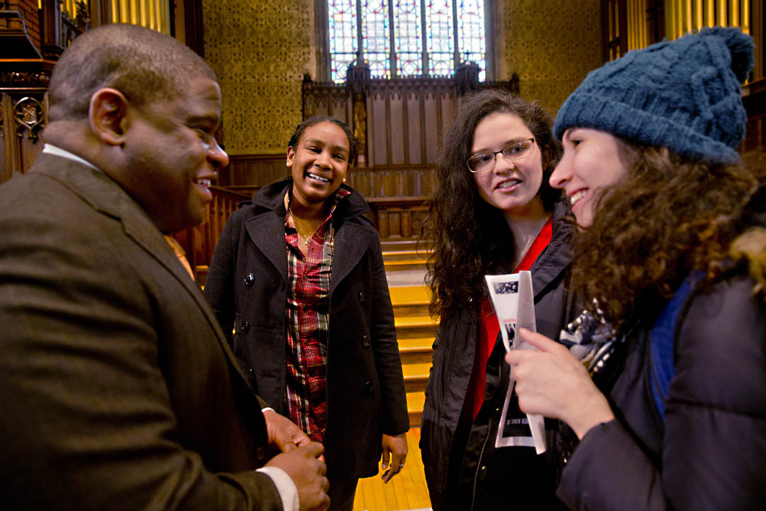 From left, Gary Younge chats with his cousin Cheri-Ann Parris '13, Simone Schriger '14 and  Stephanie Caplan '14 at the MLK Day keynote program's conclusion.  (Phyllis Graber Jensen/Bates College)