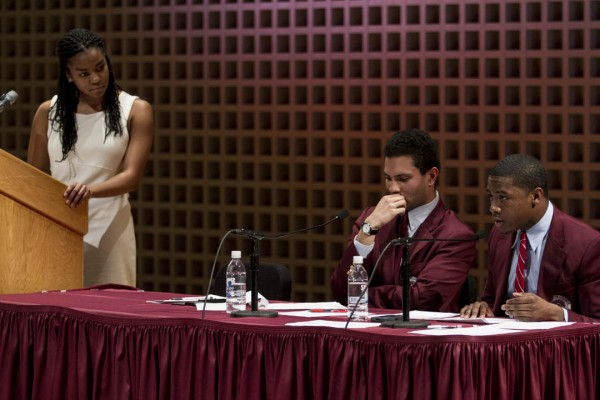 Debater Shannon Griffin '16, left, listens to an objection Monday during The Reverend Benjamin Elijah Mays Debate between Bates and Morehouse colleges in the Olin Arts Center. (Sarah Crosby/Bates College)