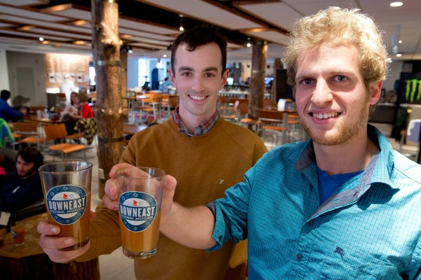 Downeast Cider co-founders Tyler Mosher '11 (left) and Ross Brockman '11 held a tasting in the Bobcat Den last spring. (Phyllis Graber Jensen/Bates College)
