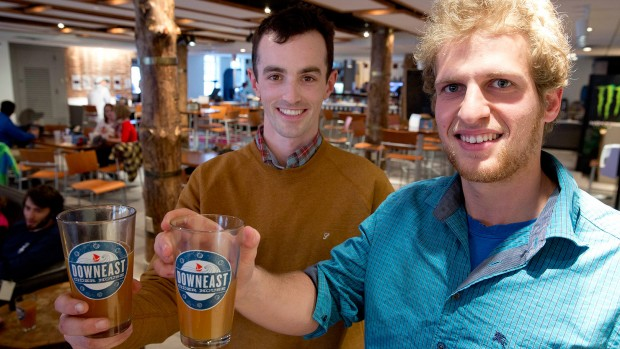 Down East Cider co-founders Tyler Mosher '11 (left) and Ross Brockman '11 held a tasting in the Bobcat Den last spring. (Phyllis Graber Jensen/Bates College)