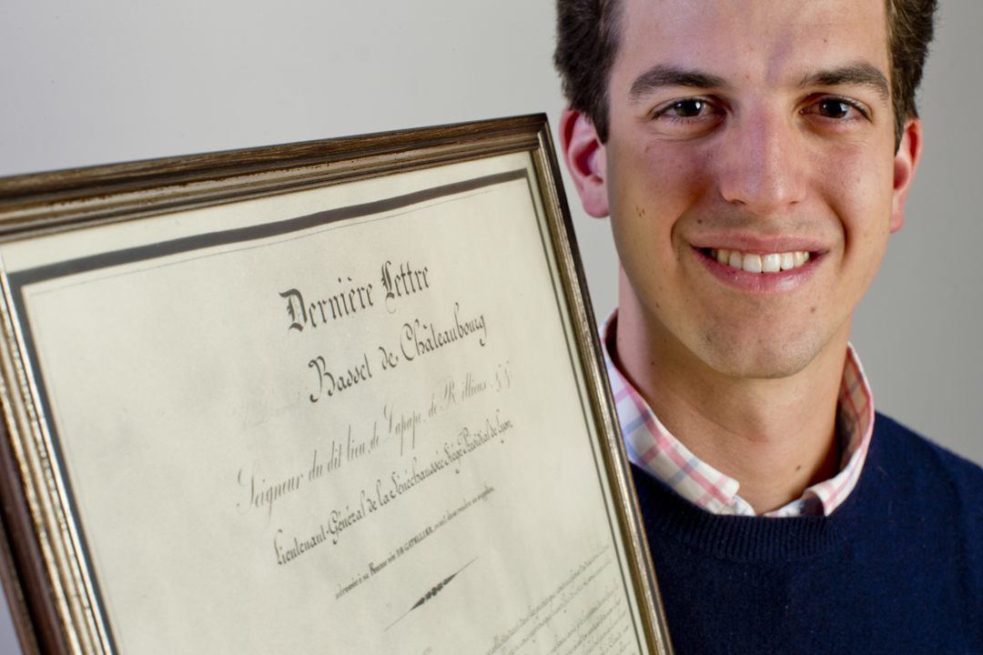 "Hank Schless '14 of Old Greenwich, Conn., holds the document that inspired his French thesis: ""La Dernière Lettre"" (The Last Letter), written by an 18th-century ancestor who was executed during the French Revolution. (Phyllis Graber Jensen/Bates College)"