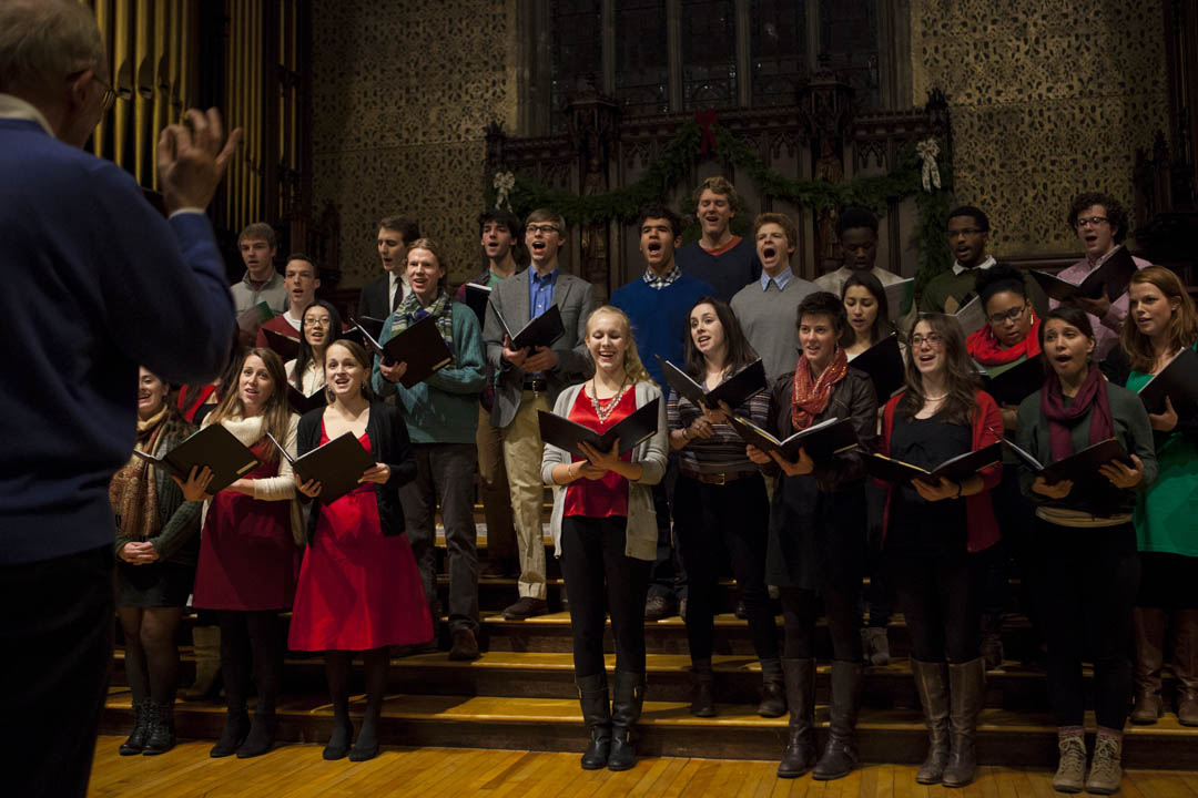 The College Choir, conducted by John Corrie,  sings during the Service of Lessons and Carols in Gomes Chapel, sponsored by the Multifaith Chaplaincy. (Sarah Crosby/Bates College)