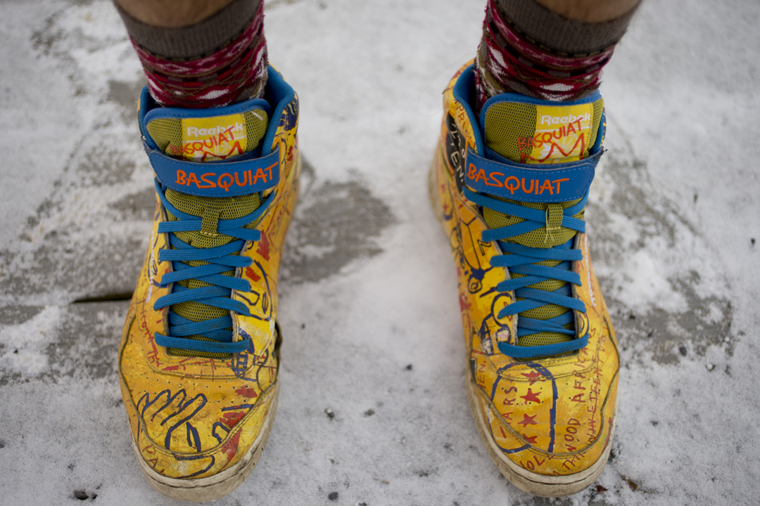 """It's sort of like time travel,"" says Jeremy Mack '16 of Brooklyn, N.Y., a double major in East Asian studies and politics, describing his thrift-shop excursions. These Reeboks, a recent purchase, are inspired by Jean-Michel Basquiat's painting ""Hollywood Africans."" (Phyllis Graber Jensen/Bates College)"