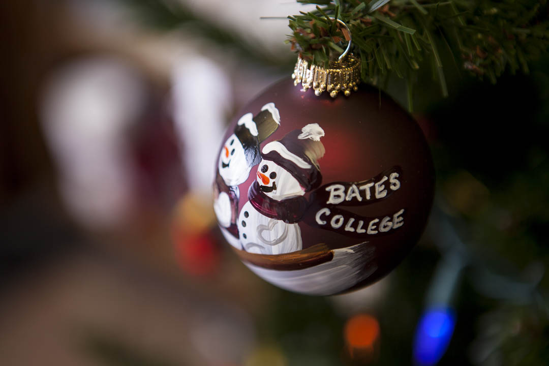 A handpainted Christmas ornament hangs from a tree in the College Store. (Sarah Crosby/Bates College)