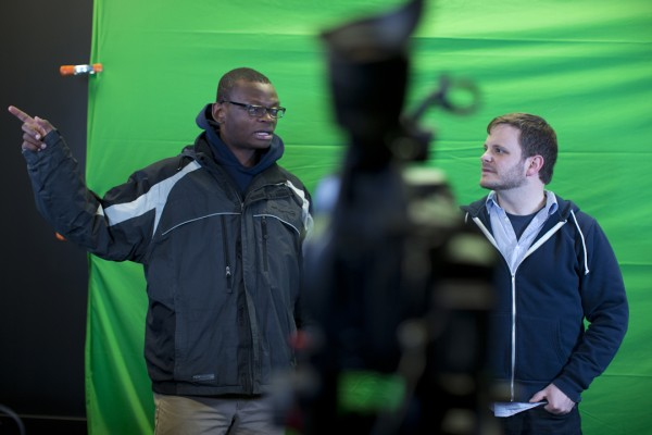 Joshua Ajamu '14, a rhetoric major from Breinigsville, Pa., helps Colin Kelley set up a new multimedia studio in Pettigrew. Ajamu is president of the Bates College Television Network, and Kelley is a digital medial specialist. (Phyllis Graber Jensen/Bates College)
