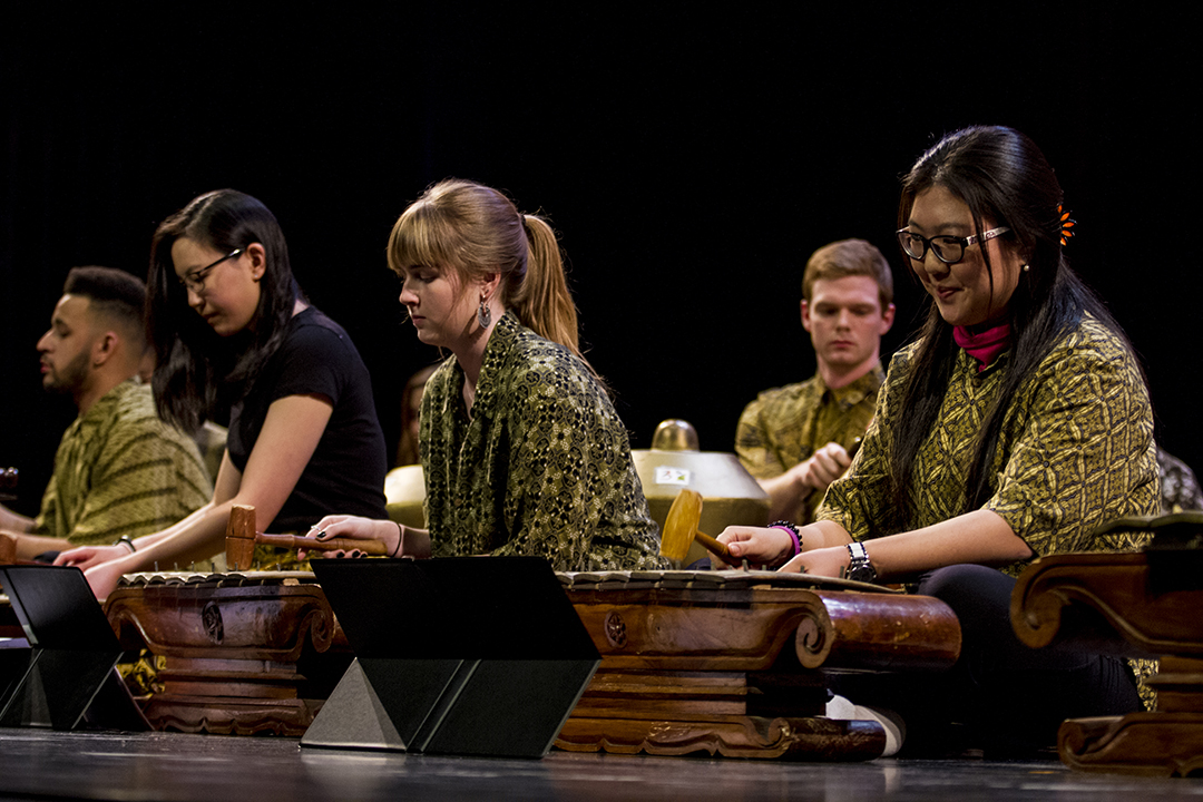 Musicians in the Bates College Gamelan Orchestra  perform during Sangai Asia's presentation of Asia Night in Schaeffer Theatre. (Sarah Crosby/Bates College)