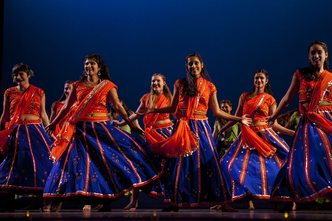 Bates College Bollywood fills the stage with colorful movement during Sangai Asia's presentation of Asia Night. (Sarah Crosby/Bates College)