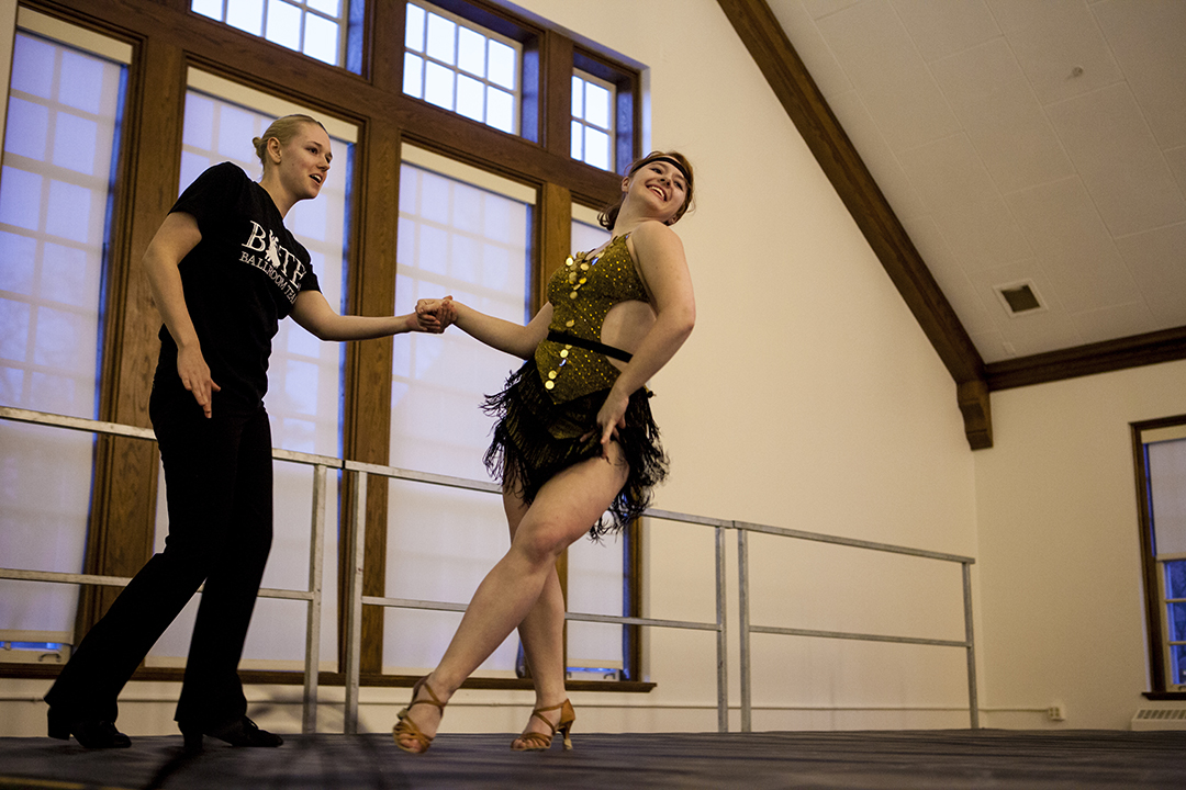 From left, Bates Ballroom Team dancers Joanna Moody '14 and Regan Radulski '15 demonstrate dancing styles during the fourth annual Arts Crawl. (Sarah Crosby/Bates College)