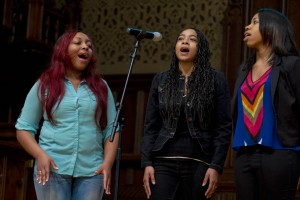 Members of the Gospelaires perform during Bates' 2014 Martin Luther King Jr. Day keynote session. (Sarah Crosby/Bates College)