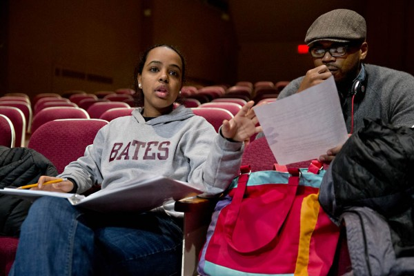 Sankofa co-directors Bethel Kifle '14 of Chicago, Ill., and Jourdan Fanning '14 of Memphis, Tenn., confer during rehearsal in Schaeffer Theatre. (Phyllis Graber Jensen/Bates College)