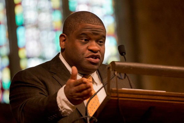 "Journalist Gary Younge offers the Martin Luther King Jr. Day keynote address at Bates, an analysis of King's ""I Have a Dream"" speech, in the Gomes Chapel on Jan. 20. (Phyllis Graber Jensen/Bates College)"