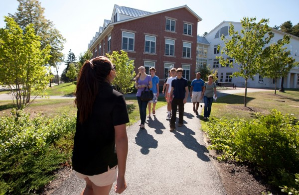 Janelle Lyford '13, admission tour guide, gives a midsummer tour of the Bates campus.