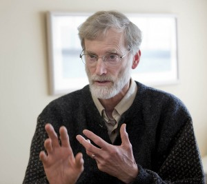 Religious studies professor Tom Tracy appears in his classroom in an image by Phyllis Graber Jensen.