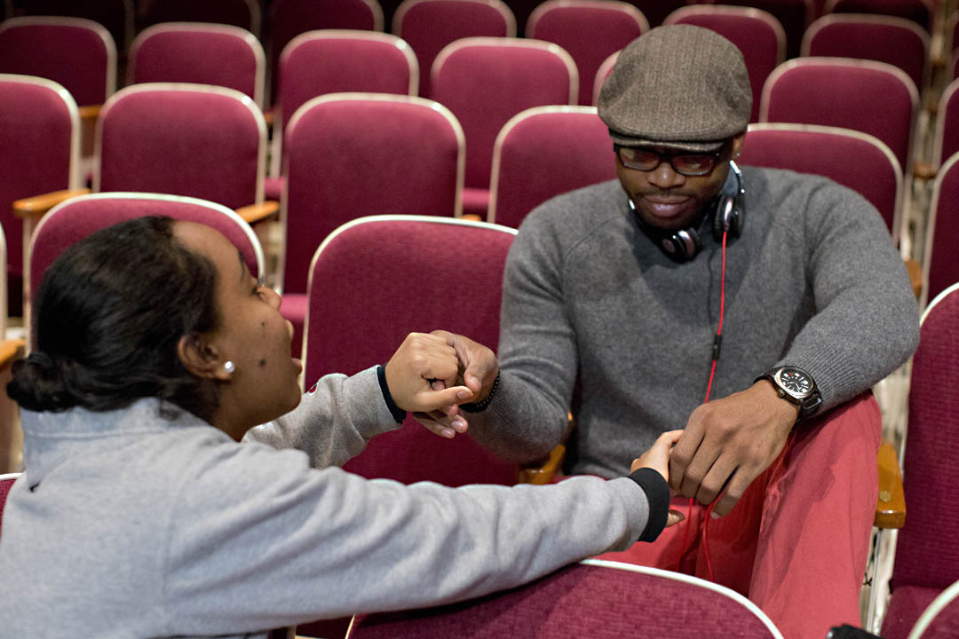 Sankofa co-directors Bethel Kifle '14 (left) and Jourdan Fanning '14 pause during a Schaeffer Theatre rehearsal to offer each other encouragement. The student production, held annually on the evening of Martin Luther King Jr. Day, uses the performative arts to explore blackness within African diasporic experiences. (Phyllis Graber Jensen/Bates College)