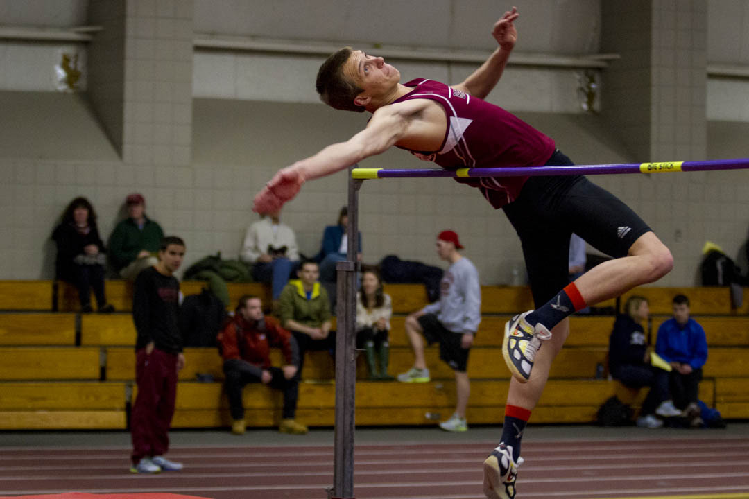 Detmer Kremer '16 competes in the high jump in Merrill Gym during a home meet vs. Colby and MIT. (Sarah Crosby/Bates College)