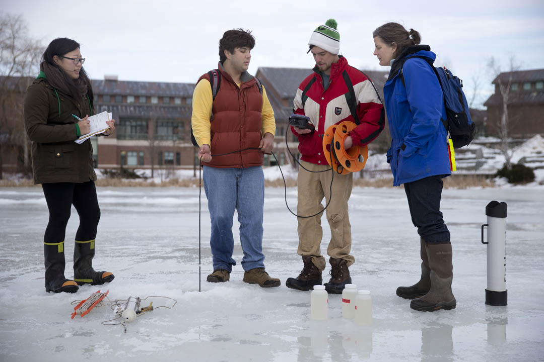 Professor of Geology Beverly Johnson (right) joins her environmental geochemistry students to study the water quality of Lake Andrews as a prelude to research they will conduct on Taylor Pond in Auburn. (Phyllis Graber Jensen/Bates College)