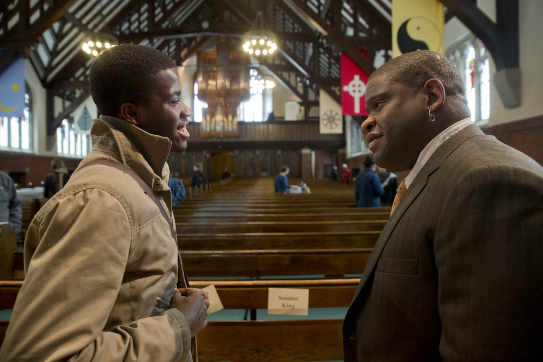 "Akachukwu Obi '15 (left) speaks with Gary Younge, the college's Martin Luther King Jr. Day keynote speaker,  after the journalist delivered the keynote address, an analysis of King's ""I Have a Dream"" speech in the Gomes Chapel. (Phyllis Graber Jensen/Bates College)"