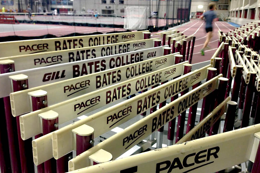 A Bates runner takes evening laps at the indoor track in Merrill Gymnasium. (Phyllis Graber Jensen/Bates College)